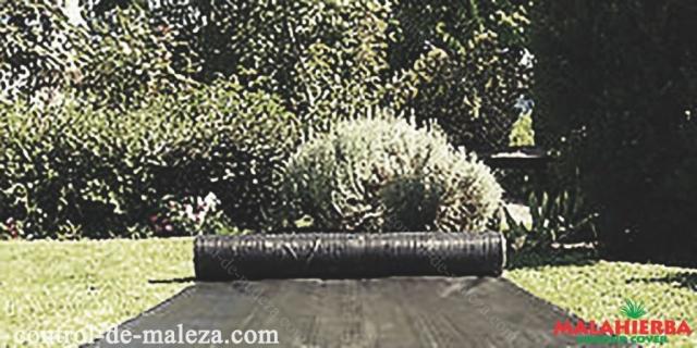 Instalación de malla anti-maleza GROUNDCOVER en jardín